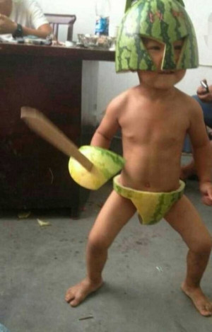 8A 2013 08 12 WatermelonSpartan 300x469 China Internet Trend: Babies Wearing Watermelons As Clothes